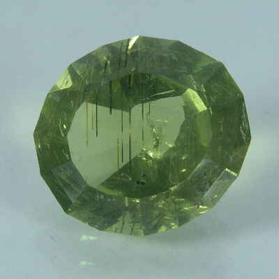 faceted, oval cut green apatite, tanzania